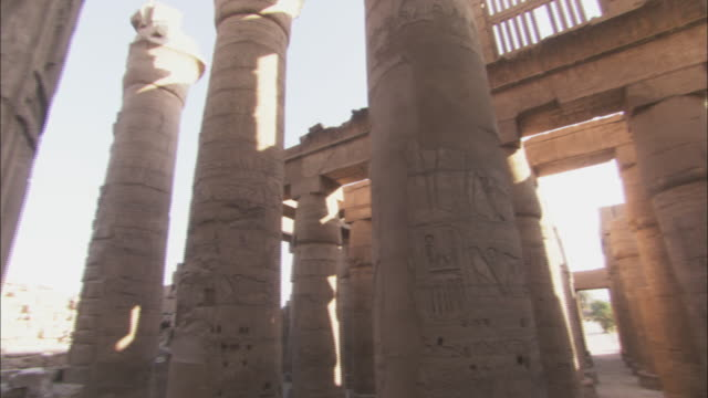 many columns comprise ancient ruins in karnak, egypt. - temples of karnak stock videos and b-roll footage