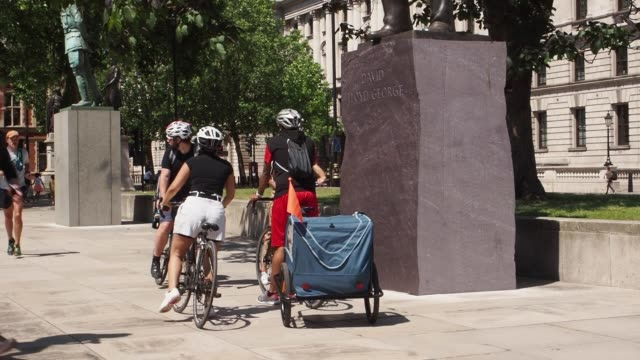 many cyclists and tourists enjoyed warm weather in london with some medics warning the government's decision to further ease lockdown restrictions... - cycling stock videos & royalty-free footage