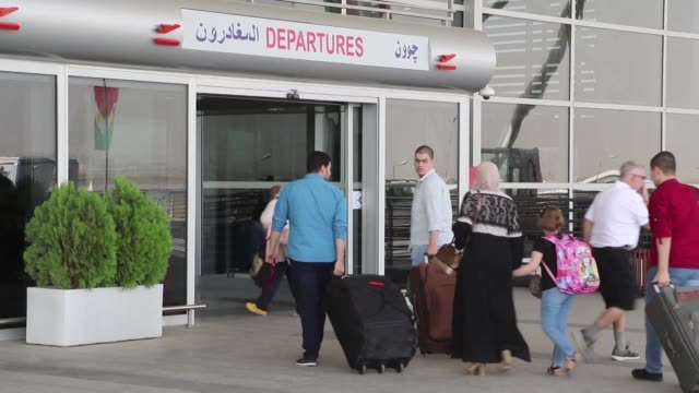 Many foreigners staying in Arbil were seen heading to the Iraqi Kurdish capital's international airport Thursday to return home ahead of a flight ban...