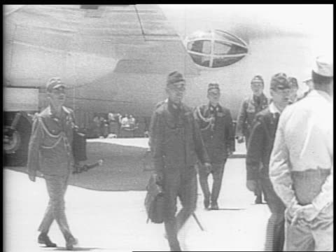 many gi's surrounding a plane / map of the pacific noted travel from japan to philippine islands / soldiers waiting in group on an airfield /... - arrendersi video stock e b–roll
