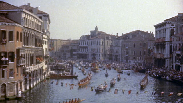 ms many gondolas in water carnival along grand canal / venice,  italy  - grand canal venice stock videos & royalty-free footage