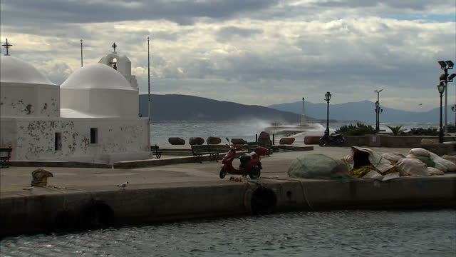 many greek islanders are hoping that the summer will bring a little prosperity. shows exterior shots aegina islands, fish market and fishing harbour,... - prosperity stock videos & royalty-free footage