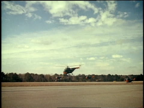 1967 montage many helicopters taking off from landing strip / fort campbell, kentucky, united states - vietnamkrieg stock-videos und b-roll-filmmaterial