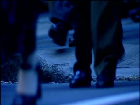 many hurrying feet along pavement with a blue tint. - menschliche gliedmaßen stock-videos und b-roll-filmmaterial
