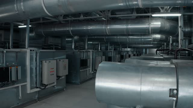 many large pipes in a factory with a control system - group of objects stock videos & royalty-free footage