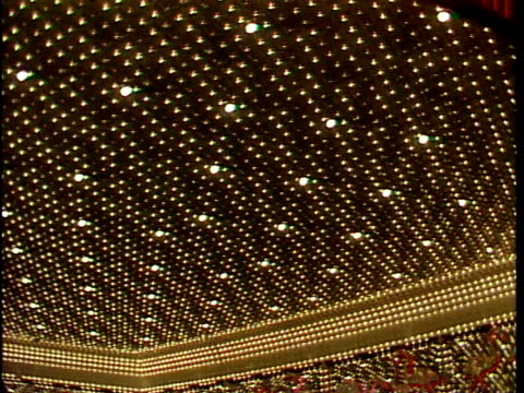 many lights close together, glitter, glitz, flamingo hotel & casino lights, to bally's marquee w/ sammy davis jr. & jerry lewis listed under... - bally's las vegas stock videos & royalty-free footage