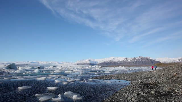 ws many melting glaciers floating at jokulsarlon lake / iceland - icecap stock videos and b-roll footage