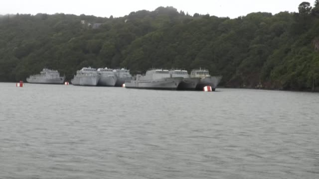 many military ships make a final port of call at the landévennec marine cemetery, at the end of brest harbour, in a bend of the aulne river. but the... - harbour stock videos & royalty-free footage