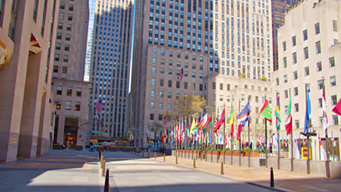 many national flags at rockefeller center. empty street. sunset. - flag stock videos & royalty-free footage