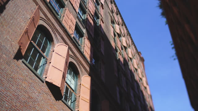stockvideo's en b-roll-footage met many opened pink steel window doors at loft building along the alley in soho district at new york city ny usa on may. 22 2019. - loft