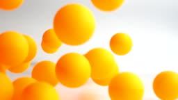 many orange balls falling in slow motion