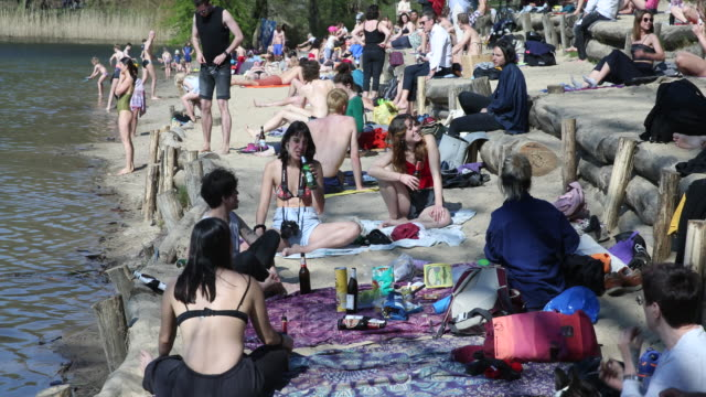 many people enjoy easter sunday at over 20 degrees celsius on krumme lanke in the berlin district of zehlendorf although some try to keep a certain... - swimming costume stock videos & royalty-free footage