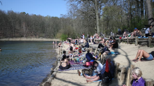 many people enjoy easter sunday at over 20 degrees celsius on krumme lanke in the berlin district of zehlendorf, although some try to keep a certain... - party social event stock videos & royalty-free footage
