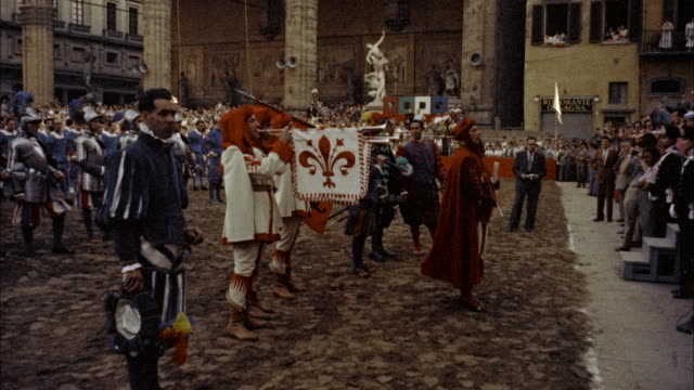 ms many people in old costumes and trumpeters blowing in pageantry scenes / florence, italy - trumpet stock videos and b-roll footage