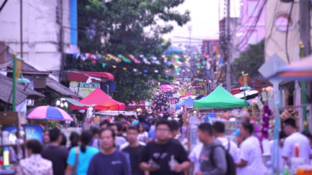 many people making their way through the market in thailand - street market stock videos & royalty-free footage
