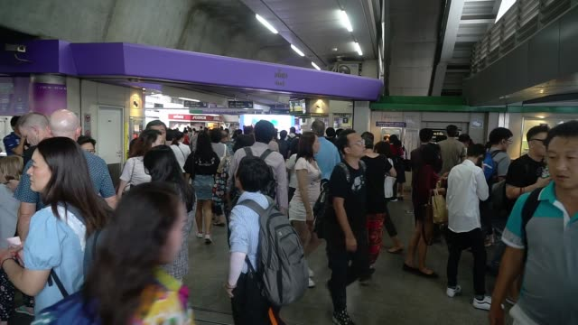 many people walk on the asok bts station bangkok thailand. - capital cities stock videos & royalty-free footage