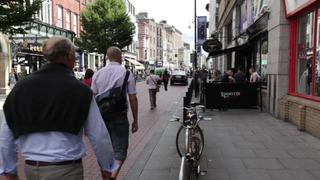 MS Many people walking on street of brick / Dublin, Ireland