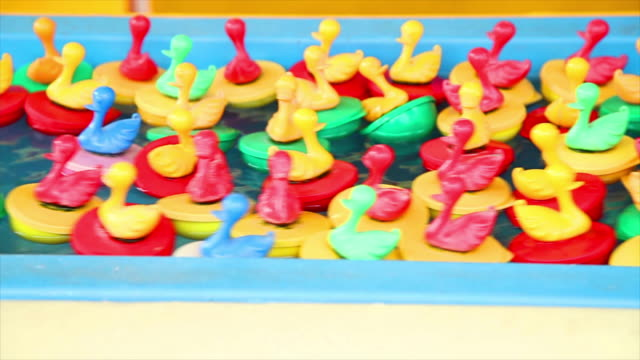many plastic ducks floating in the pool - plastic stock videos & royalty-free footage