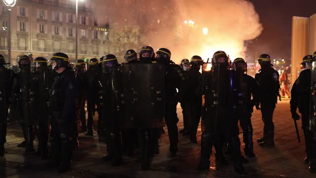 many policemen protect themselves with their shields in front of a fire while numerous clashes take place during the demonstration to protest against... - france stock videos & royalty-free footage