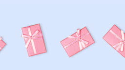 many rectangular gift boxes of pink color with ribbon and bow close-up against a blue background, seamless looping animation