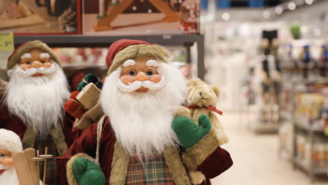 many santa claus decoration toys displayed in shop - weihnachtsmütze stock-videos und b-roll-filmmaterial