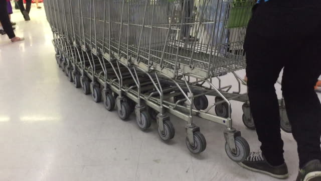 many shopping cart trolley in line on escalator - collection stock videos & royalty-free footage