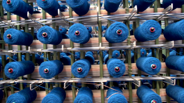 many skein threads for embroidery machines on work in factory. - ball of wool stock videos & royalty-free footage