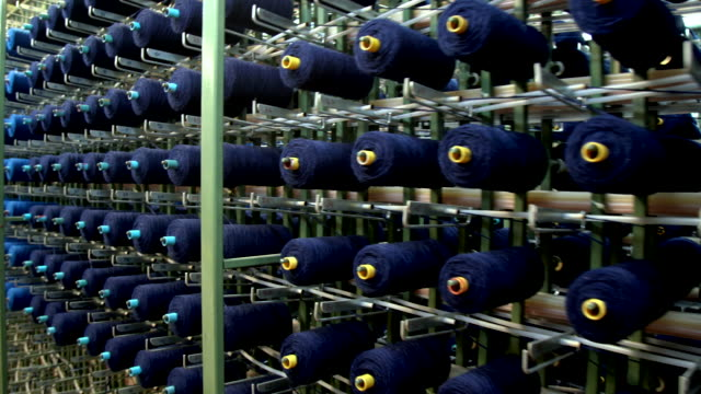 many skein threads for embroidery machines on work in factory. - wool stock videos & royalty-free footage