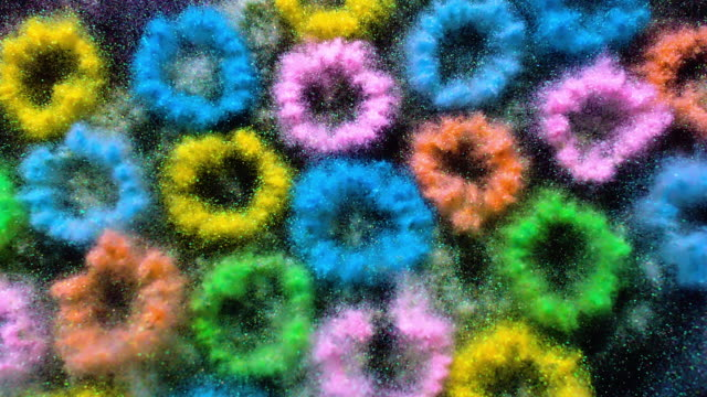 many small circles made with multi pastel colored glitter powder exploding towards camera and becoming defocused on black background, glittering bokeh - pastel colored stock videos & royalty-free footage