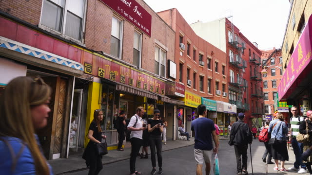 many stores and restaurants open along the both side of doyers street in china town at new york city ny usa on may 22 2019. - placard stock videos & royalty-free footage