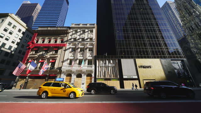many stores boarded up store windows on fifth avenue in midtown manhattan to prevent possibility of riot and mob violence for result of the... - french flag stock videos & royalty-free footage
