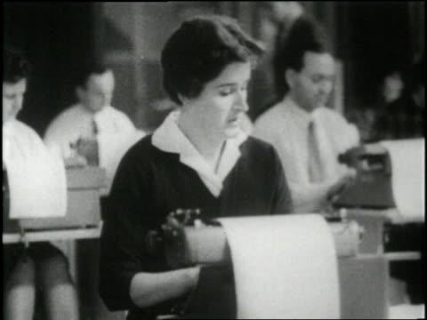 many typists work in an office - schreibmaschine stock-videos und b-roll-filmmaterial