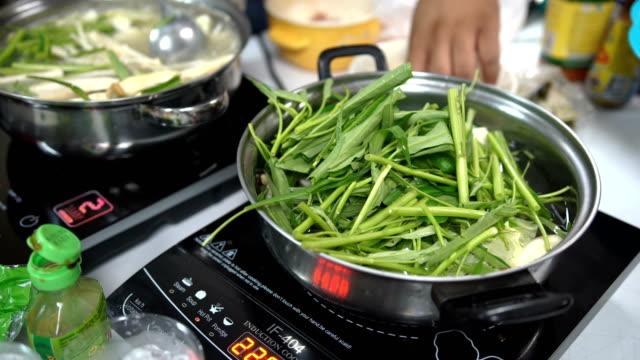 many vegetable in sukiyaki pot at home - sukiyaki stock videos and b-roll footage