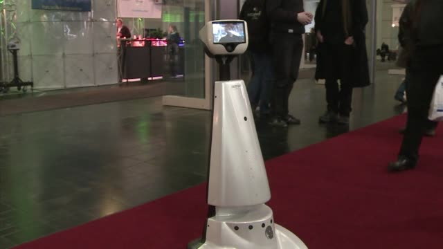 many visitors walking around cebit the world's biggest hightech fair have found themselves bumping into 'jazz' a 'telepresence' robot also ambling... - biggest stock videos & royalty-free footage