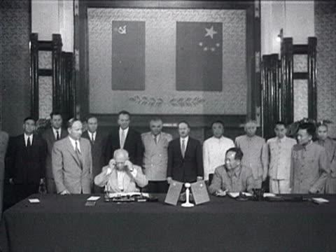 ms mao and khrushchev sign on common declaration audio / beijing pekin peking beijing china - anno 1958 video stock e b–roll