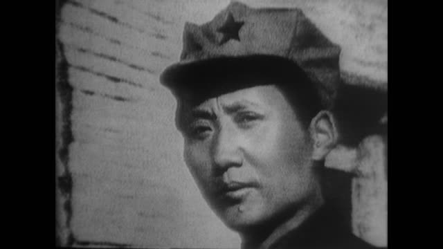 """every communist must grasp this truth: political power grows out of the barrel of a gun."" - mao tse tung video stock e b–roll"