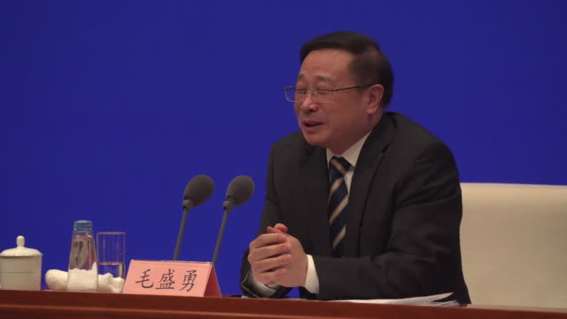 mao shengyong of the chinese national bureau of statistics saying the chinese economy has made improvements during the coronavirus crisis due to... - kommunismus stock-videos und b-roll-filmmaterial