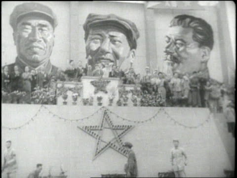 mao tsetung salutes his troops while standing in jeep three huge portraits of communist leaders decorate a wall young chinese men carry flags and... - mao tse tung stock videos & royalty-free footage