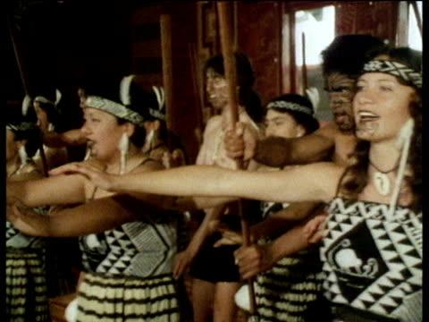 Maori teenagers perform traditional dress and face paint perform traditional Maori dance New Zealand