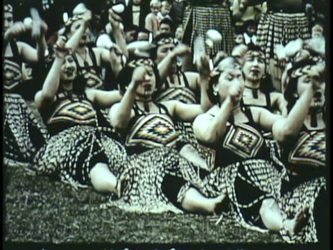 1955 montage ws ms cu pan maori traditional dancers performing in front of spectators on lawn / new zealand / audio - carving craft product stock videos & royalty-free footage