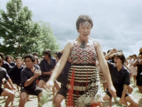 maoris dancers perform a welcoming dance for queen elizabeth at rotorua during her silver jubilee tour of new zealand 1977 - rotorua stock videos and b-roll footage