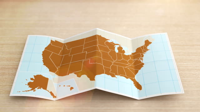 usa map folds out on desk. three in one. - usa stock videos & royalty-free footage