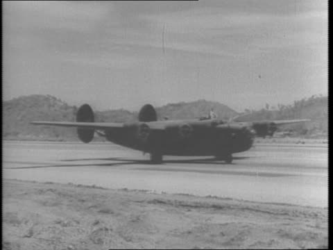 map of australia route to us / consolidated b24 liberator taxiing taking off in sky / pilot wearing mask / aerial footage of japanese ship below /... - anno 1943 video stock e b–roll