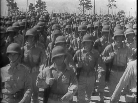 stockvideo's en b-roll-footage met map of axis powers / marines marching and winning at guadalcanal / navy firing guns on and winning at the solomon islands / madame and general chiang... - 1942