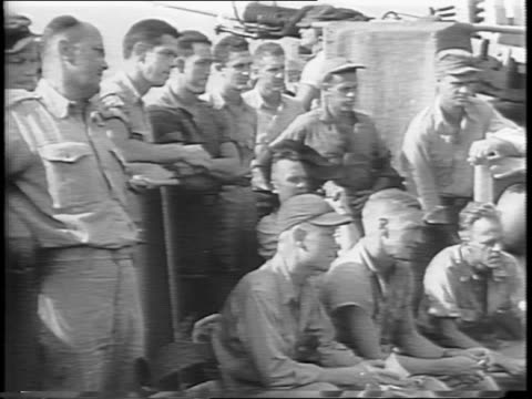 stockvideo's en b-roll-footage met map of borneo / military pt boat speeds through water / us troops group together for debrief / troops quickly put on their helmets and grab supplies - tweede wereldoorlog in azië