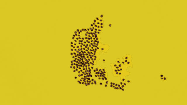 map of denmark created from coffee beans on a yelow background - traditionally czech stock videos & royalty-free footage