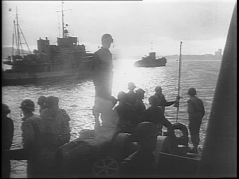 map of europe / invasion boats at dock / us soldiers marching and loading onto invasion boats / convoy leaves the port for battle / us soldier stands... - dover kent stock-videos und b-roll-filmmaterial