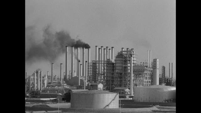 map map of iran w/ teheran abadan highlighted / oil wells marked / ha ws oil refinery w/ train moving on tracks fg / xws refinery w/ storage tanks fg... - iran bildbanksvideor och videomaterial från bakom kulisserna