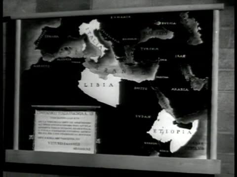 map of 'italia libia etiopia' ext ha ws muslims on horses in fascist rally ws paraders stadium bg xws fascist muslims raising hand in fascist salute... - libya stock videos & royalty-free footage