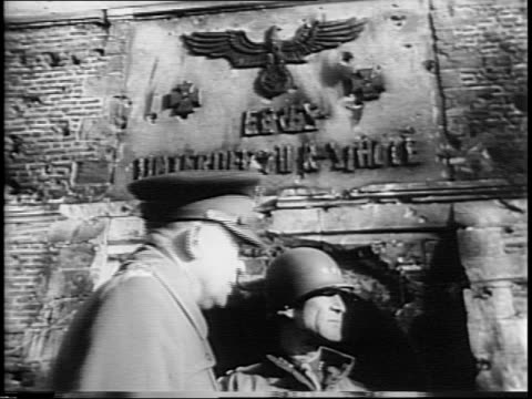 map of movement into germany / tanks roll through destroyed german cities as fires burn and smoke billows / cannons are loaded and fired / buildings... - generale grado delle forze armate video stock e b–roll